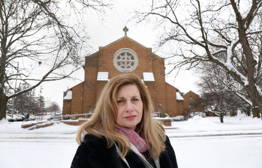 Christina Grana stands in front of St. Margaret Mary Church in Irondequoit. Grana went to the former St. Margaret Mary School across the street and says she was sexually abused by the school's principal, Sister Janice Nadeau.