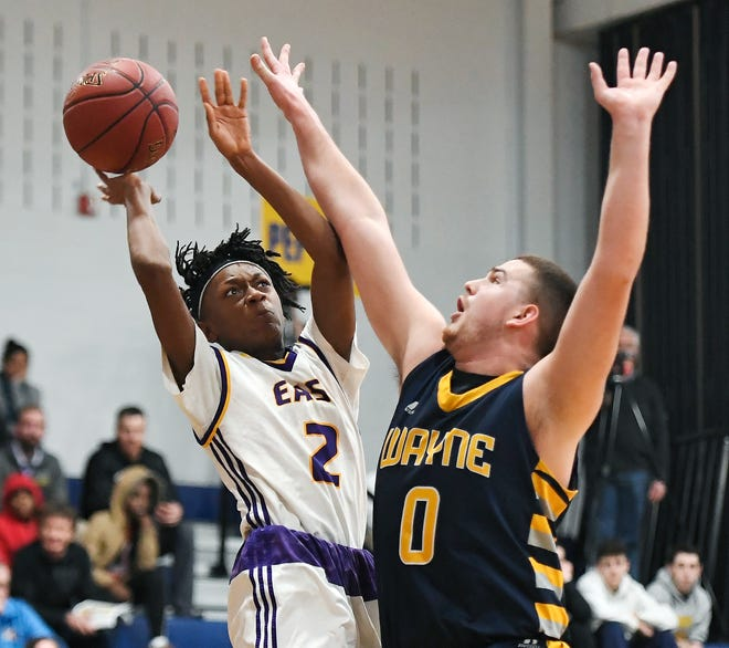 East's Kaori Barley, left, is defended by Wayne's Nick Carmichael during a Class A2 sectional semifinal played at Victor High School on Wednesday, Feb. 27, 2019. No. 1 seed East advanced to the Class A2 final with a 53-36 win over No. 4 seed Wayne.
