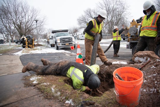 Contractors for Greenlight Networks install fiber optic cable conduits alongside existing underground utilities on Dorsetwood Drive in Greece on Tuesday, Feb. 26, 2019.