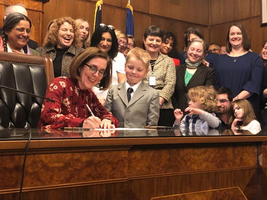 Oregon Gov. Kate Brown, a Democrat, signs into law a statewide rent control bill at the Oregon Capitol in Salem on Thursday, Feb. 28, 2019.