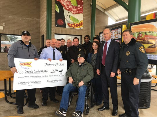 Bossier Sheriff's Deputy Daniel Golden was presented a check for money raised  at all Bossier Parish Sonic restaurants Feb. 19. Golden was struck by a vehicle while working traffic detail in January.