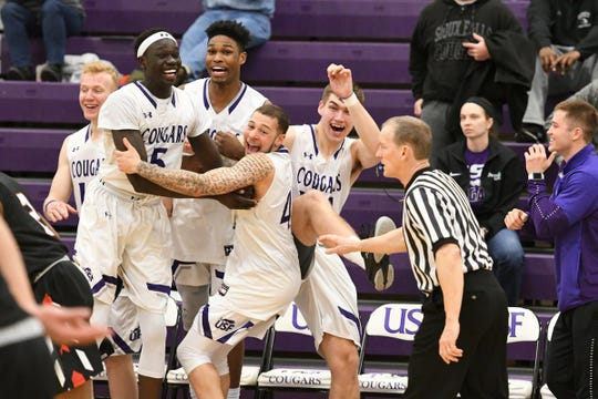 USF players celebrate during their win over Minot State Wednesday night at the Stewart Center