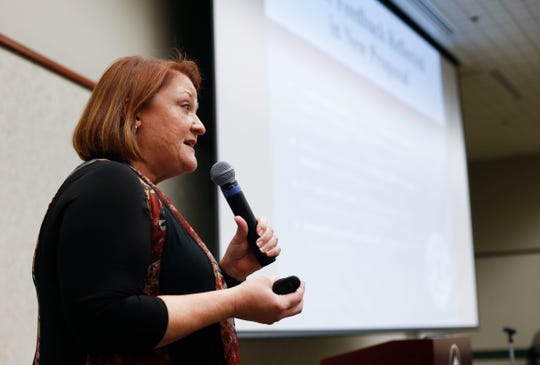 Deputy Superintendent Carol Embree speaks at a town hall meeting at the Library Center in late February. Top officials participated in more than 100 community presentations.