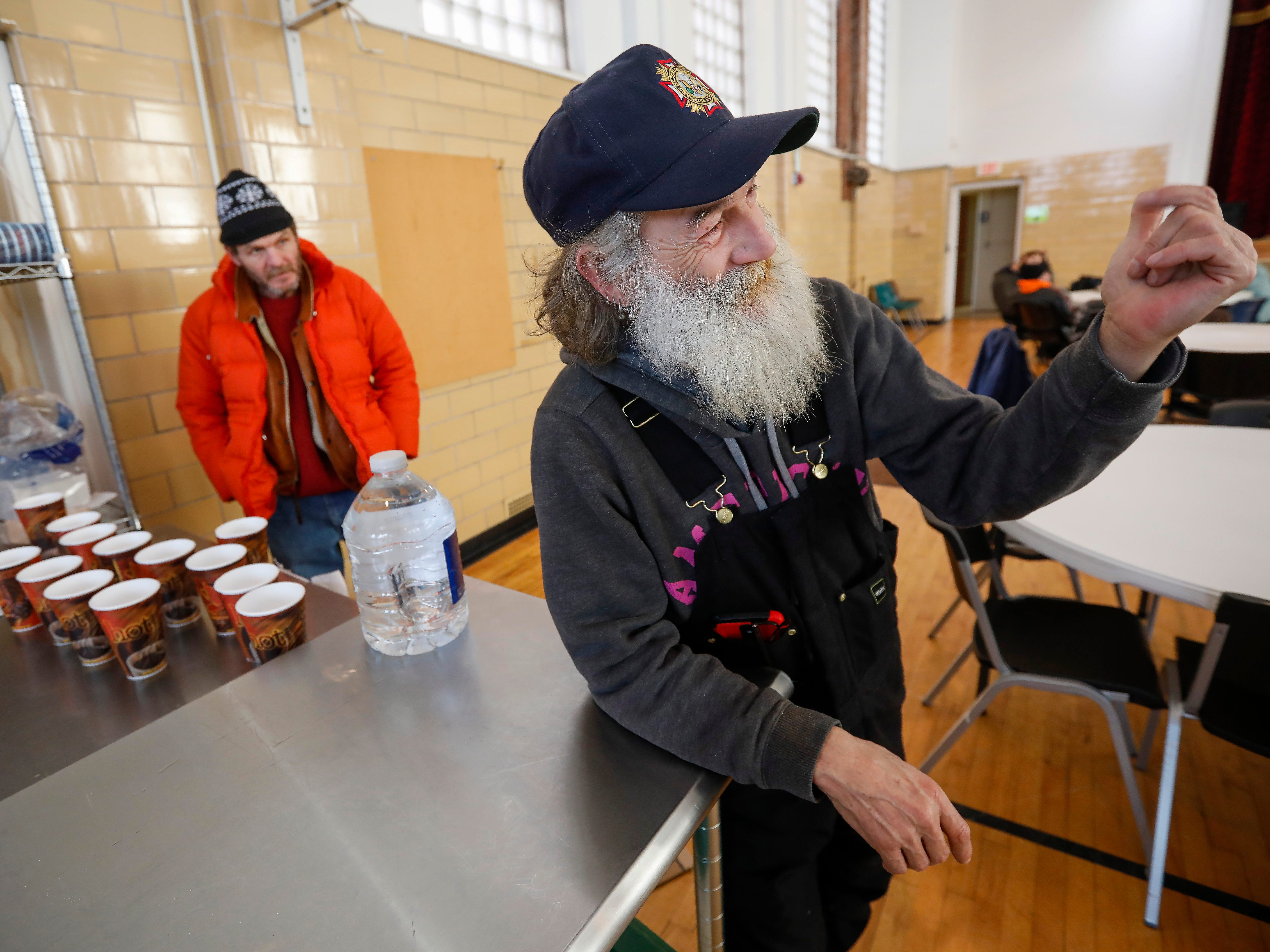 Gil Rife, right, who has been homeless for 3 years, motions to one of his friends to come talk to him at Franciscan Villa Wednesday, Feb. 20, 2019.