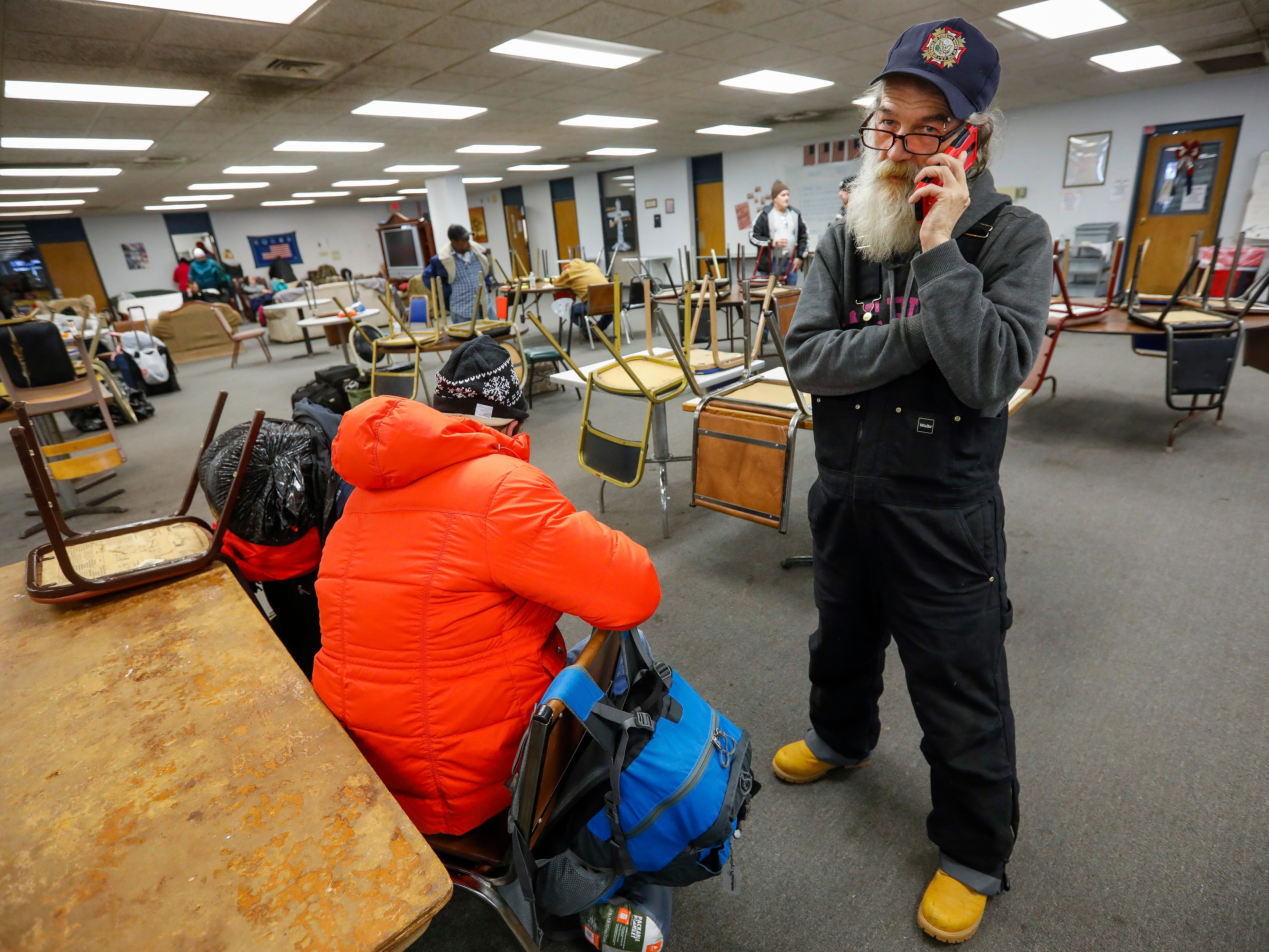 Gil Rife, who has been homeless for 3 years, talks on the phone with Stephanie Appleby, of NAMI, inside the Veteran's Coming Home Center on Wednesday, Feb. 20, 2019.