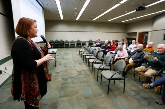 Norman and Dianne Ely asked questions during a town hall meeting Feb. 27 at the Springfield Library Center. Deputy Superintendent Carol Embree and Jill Patterson, the president of the school board, gave the presentation on the upcoming bond issue.