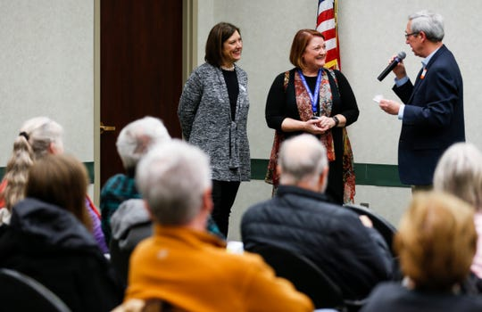 Springfield Public Schools Deputy Superintendent Carol Embree (center) and Jill Patterson, school board president, take questions at a bond issue town hall meeting at the Library Center on Wednesday, Feb. 27, 2019