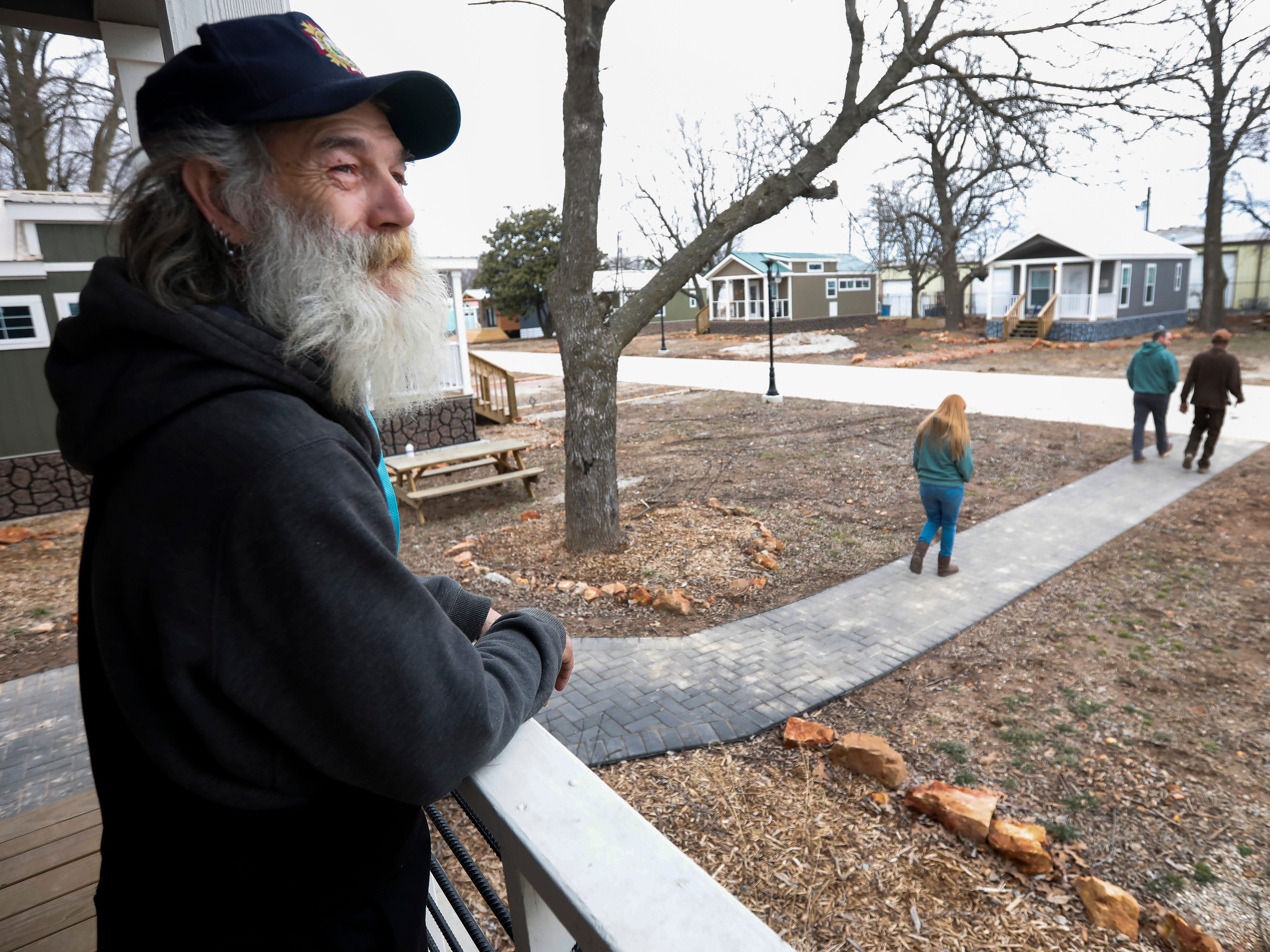 Gil Rife looks out from his new front porch at Eden Village on Thursday, Feb. 21, 2019.