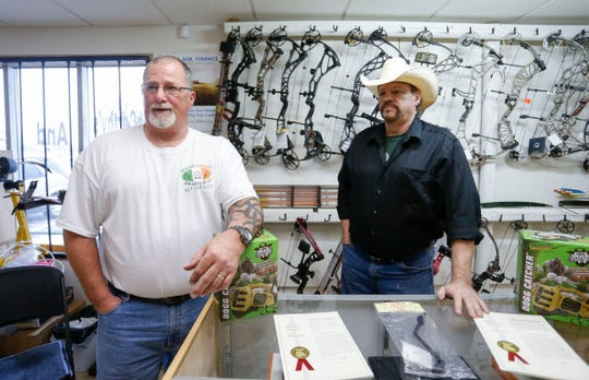 McCarthy's Outdoors and Gun Club owners Tom Younce (left) and Joe Goade talk about the outdoor shop at 1675 E. Seminole Street on Wednesday, Feb. 27, 2019.