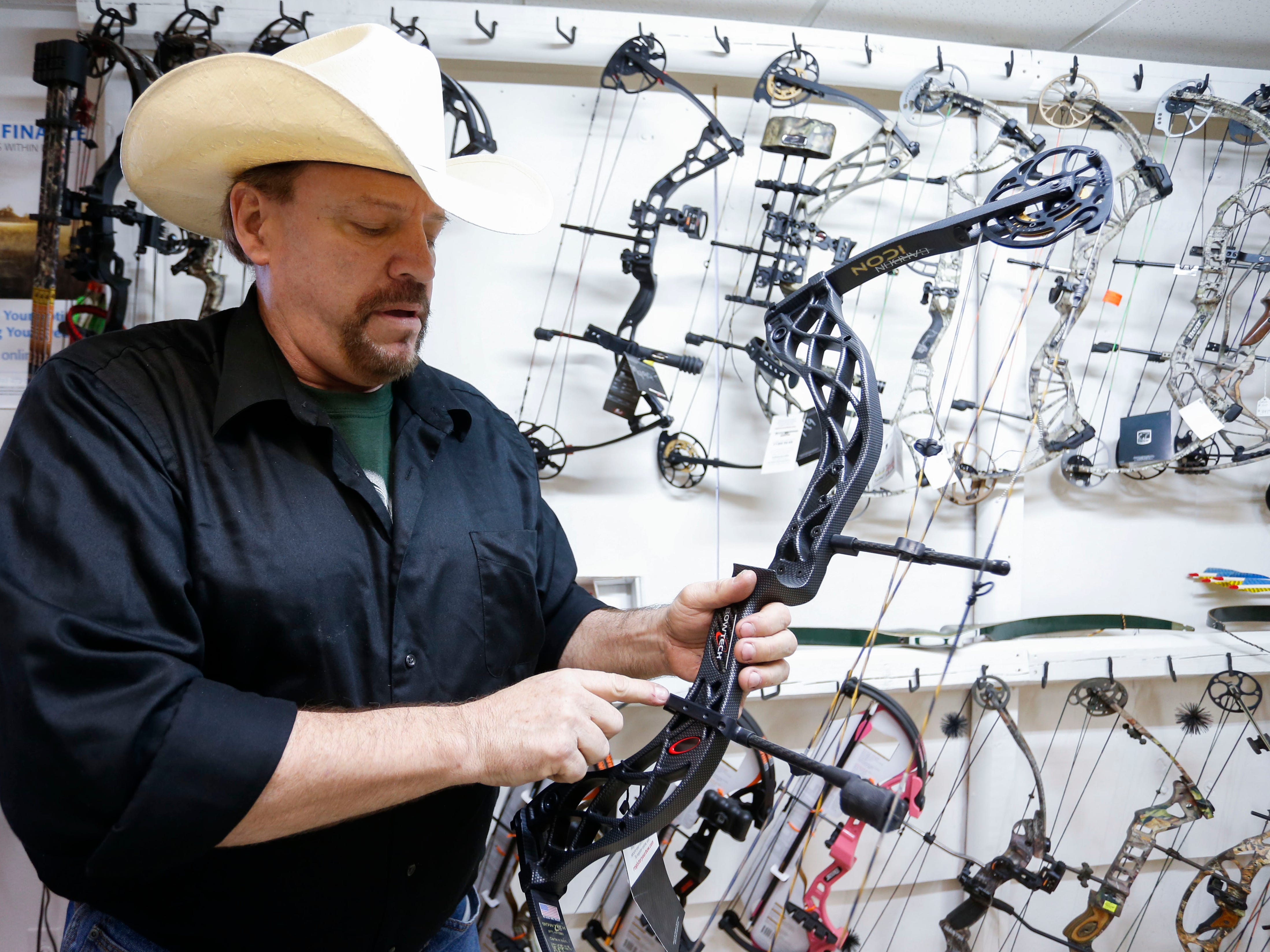 Inventor Joe Goade shows off an archery device, which he holds the patent to, that instantly stops a compound bow string after it has fired an arrow at McCarthy's Outdoors and Gun Club, the outdoor shop he is co-owner of in Springfield.