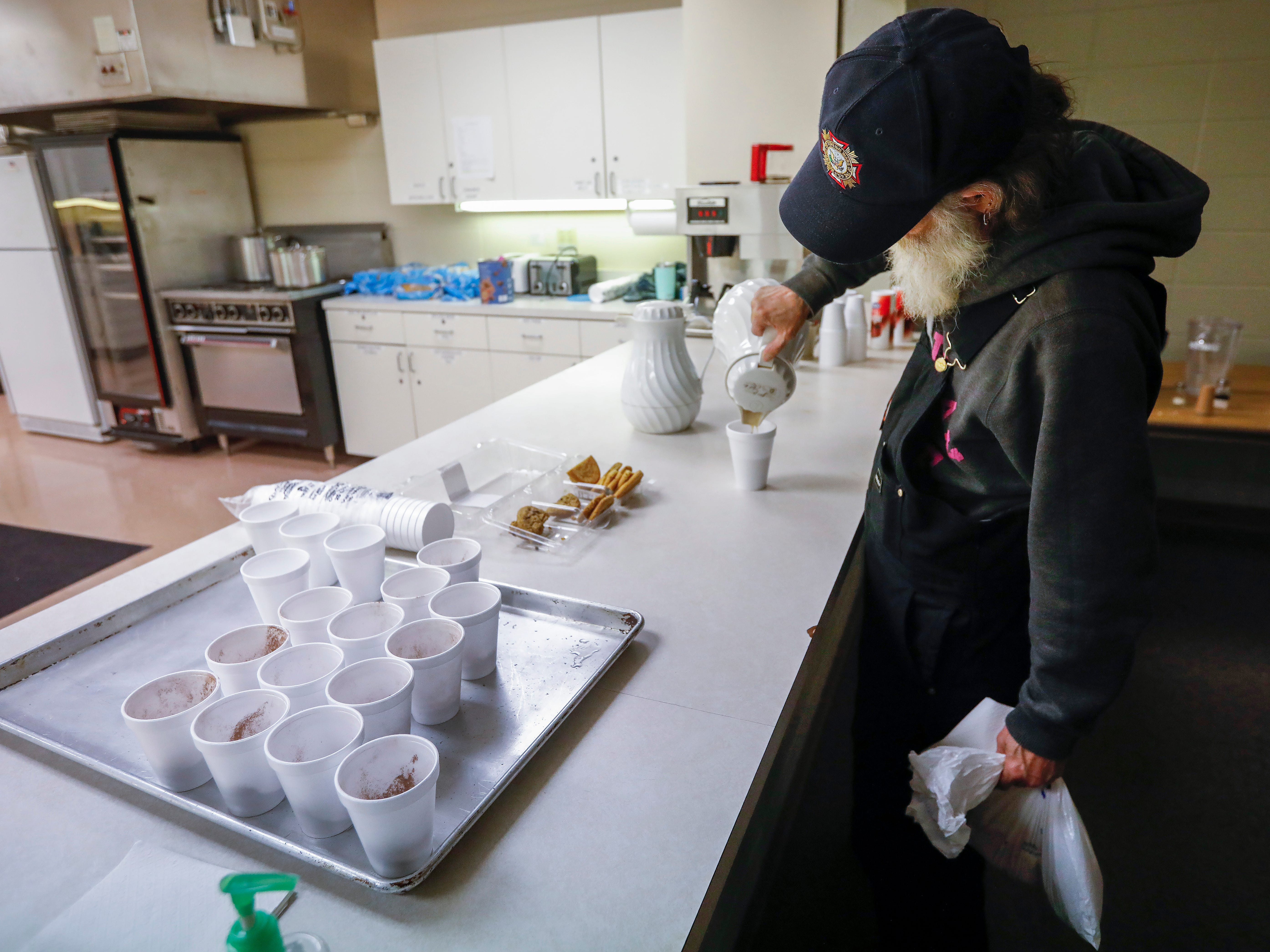 Gil Rife, who has been homeless for 3 years, pours a cup of coffee at the E. Sunshine Church of Christ on Wednesday, Feb. 20, 2019. Rife was spending the night at the church which opened it's doors as a warming center after temperatures dropped below freezing.