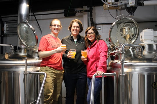 Susan McLeod and Carol McLeod, with Hold Fast Brewing, join Jennifer Leonard, with Tie & Timber Beer Co, in the Tie & Timber brewing center. The three are all Springfield brewery owners and are working to promote women brewers in the region.