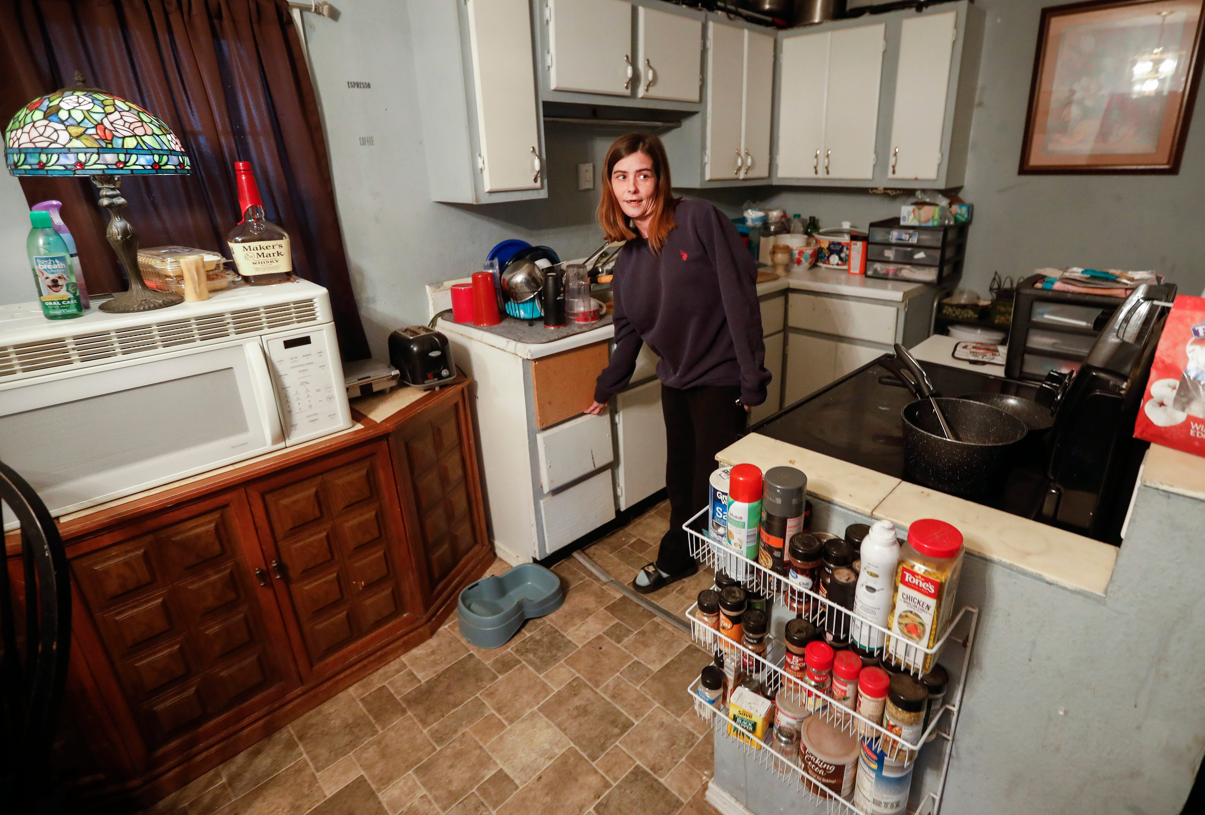 Kassandra Moore talks about the problems they have tried to fix in the home they are renting from Chris Gatley. They were recently informed that the property was being foreclosed on and that they would have to leave.
