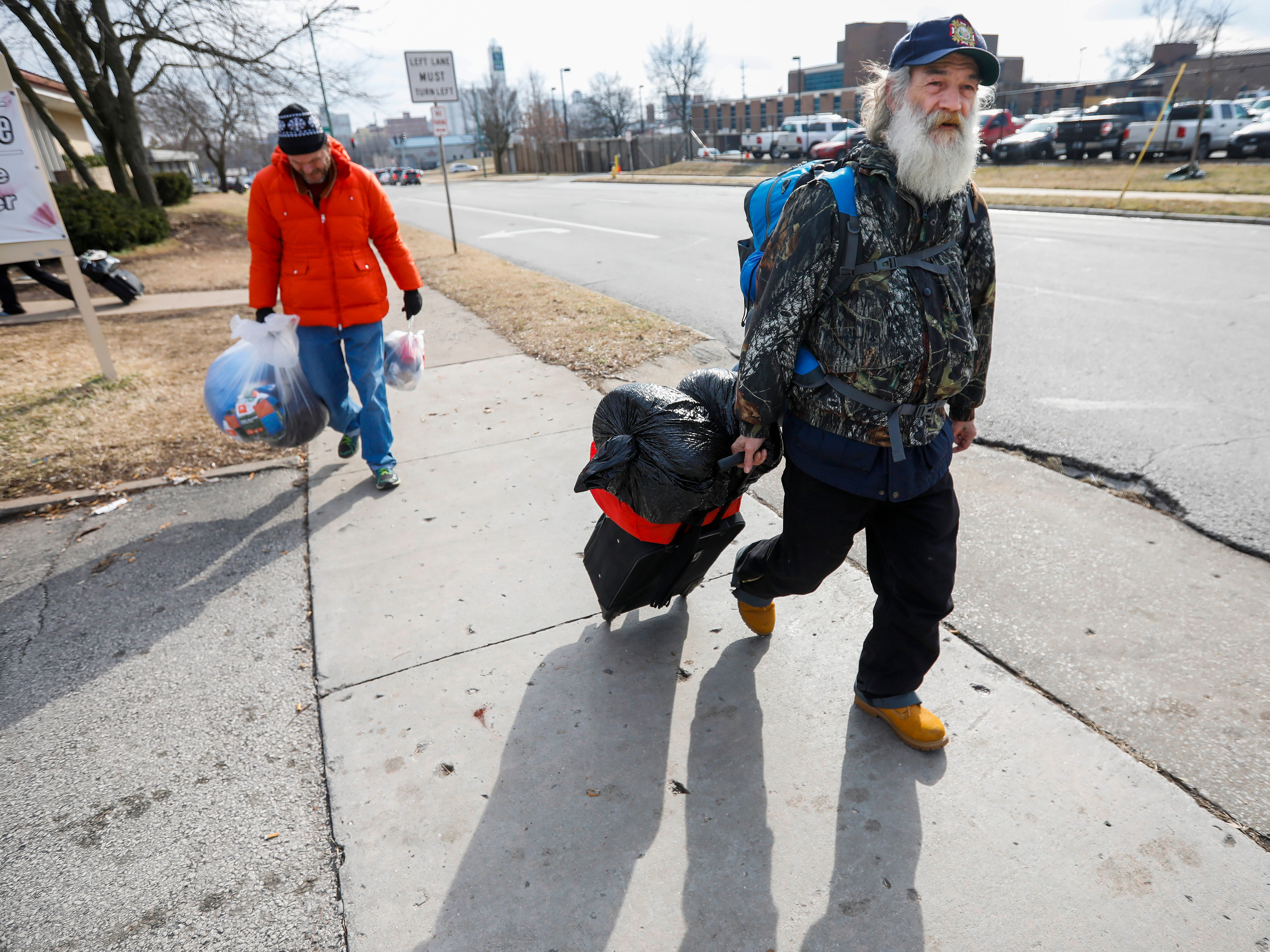 Gil Rife, right, who has been homeless for 3 years, and his friend Tommy (who didn't want to give his last name) leave the Veteran's Coming Home Center on Wednesday, Feb. 20, 2019.