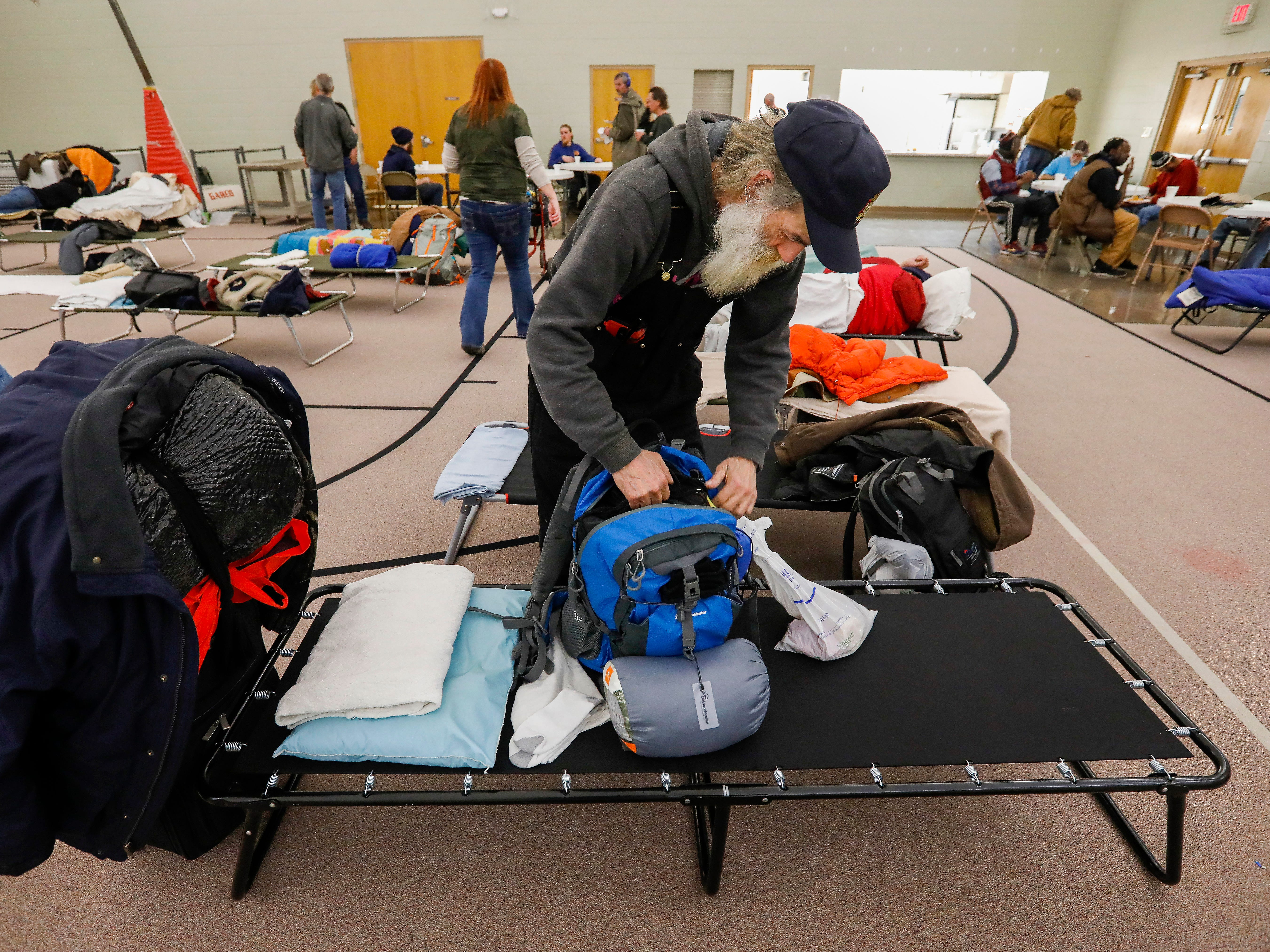 Gil Rife, who has been homeless for 3 years, sets up his cot at the E. Sunshine Church of Christ on Wednesday, Feb. 20, 2019. Rife was spending the night at the church which opened it's doors as a warming center after temperatures dropped below freezing.