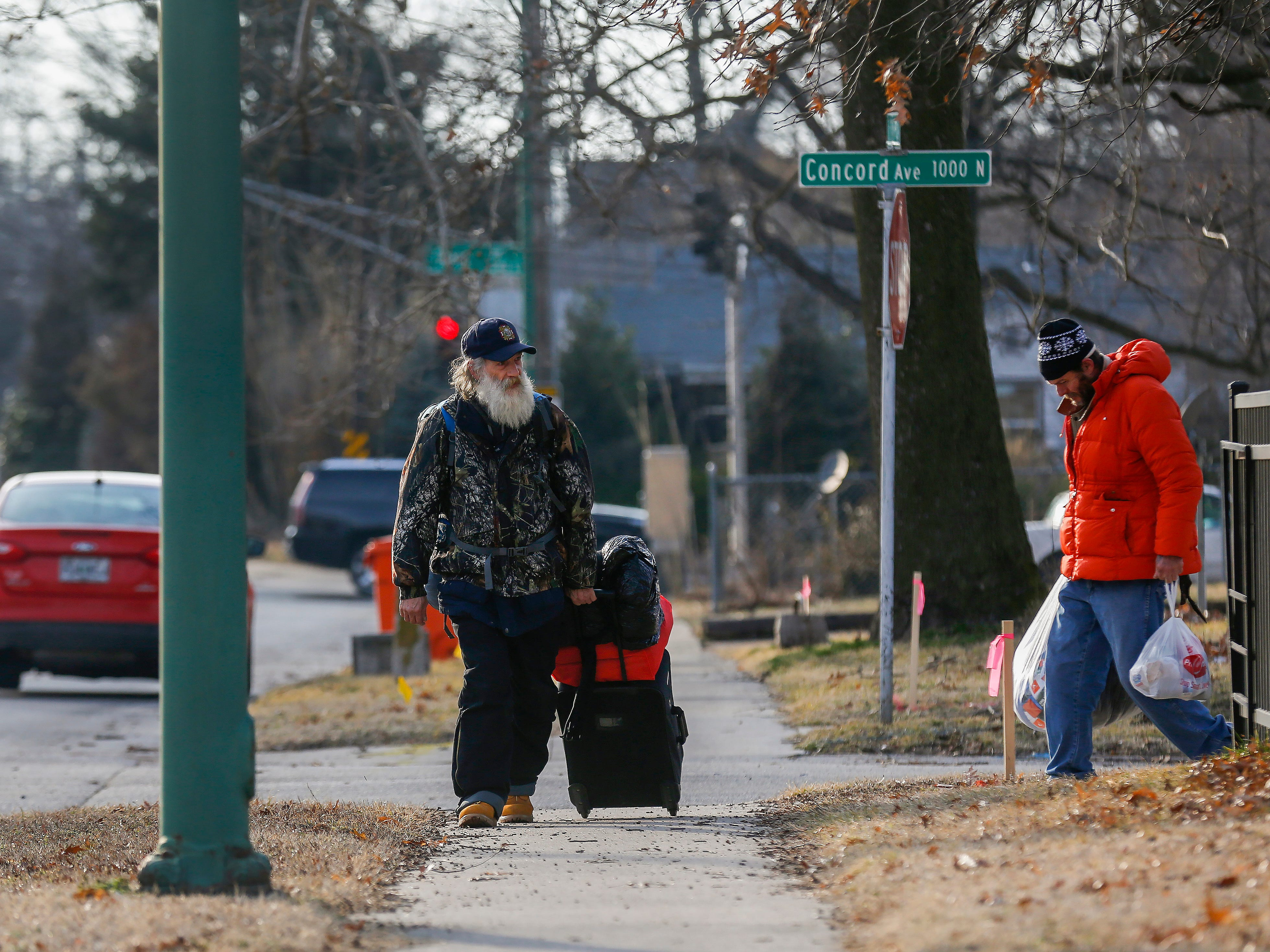 Gil Rife, who has been homeless for 3 years, walks down W. Nichols Street while on his way to Franciscan Villa for a meal on Wednesday, Feb. 20, 2019.