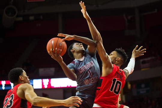 Missouri State guard Keandre Cook drives on Illinois State's Phil Fayne (10) during first half action of their Missouri Valley Conference game Wednesday, Feb. 27, 2019, at Redbird Arena in Normal, Ill.