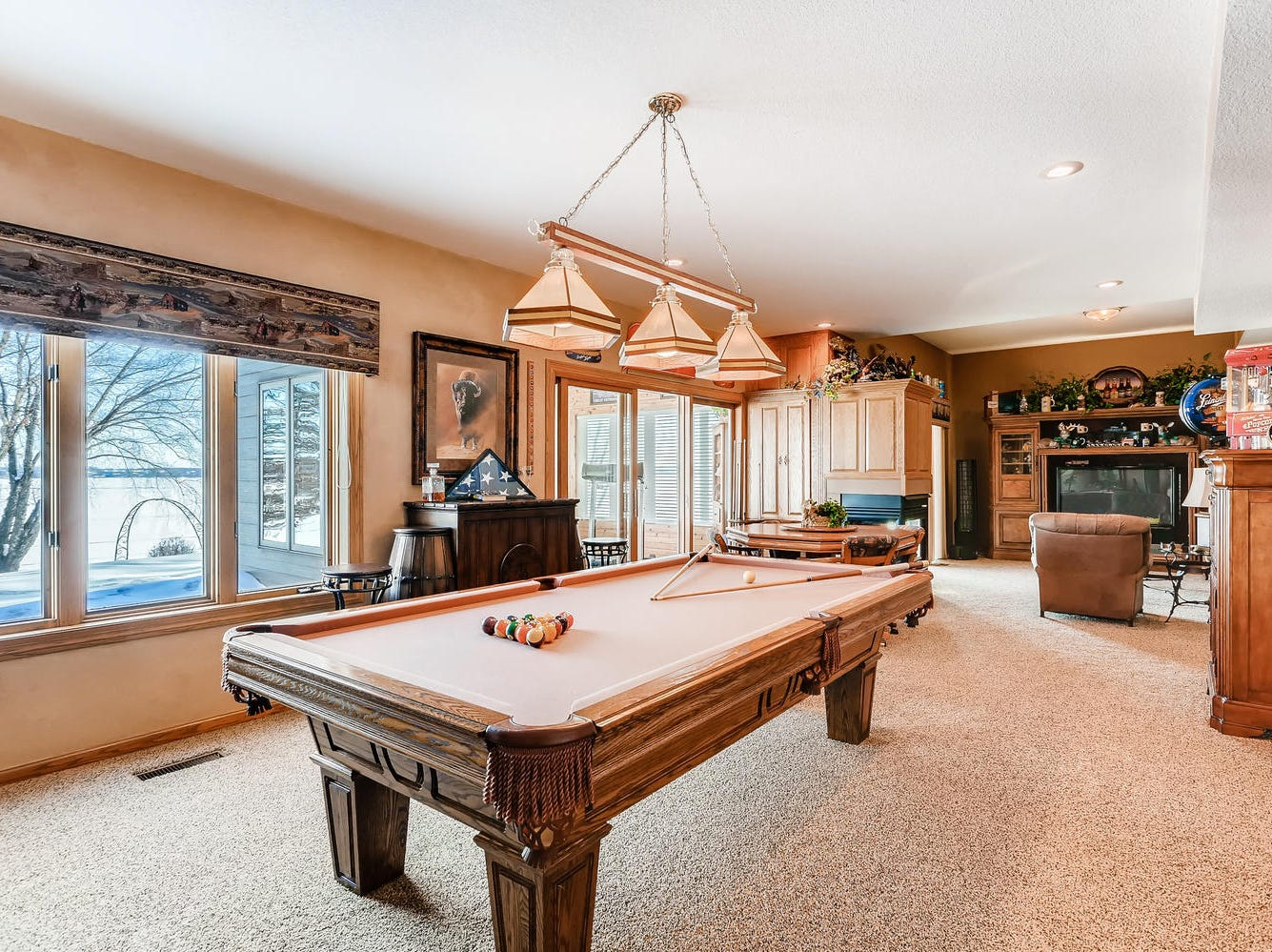 The lower level houses a large recreational space perfect for billiards and is large enough to accommodate multiple seating areas.