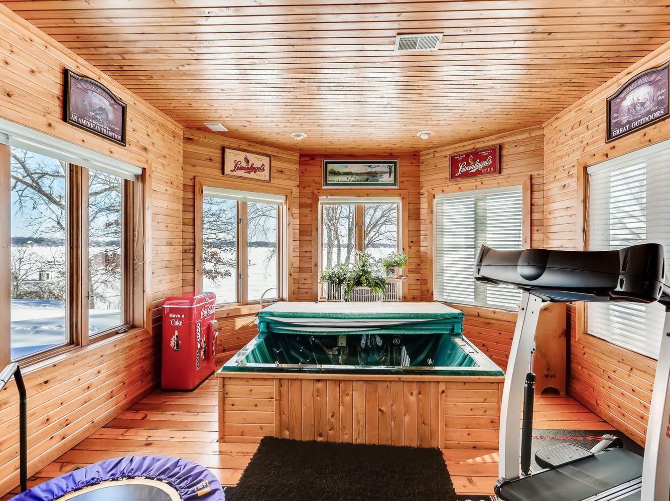 A hot tub room sits lakeside and mimics the sunroom on the main level in that it offers complete waterfront views.
