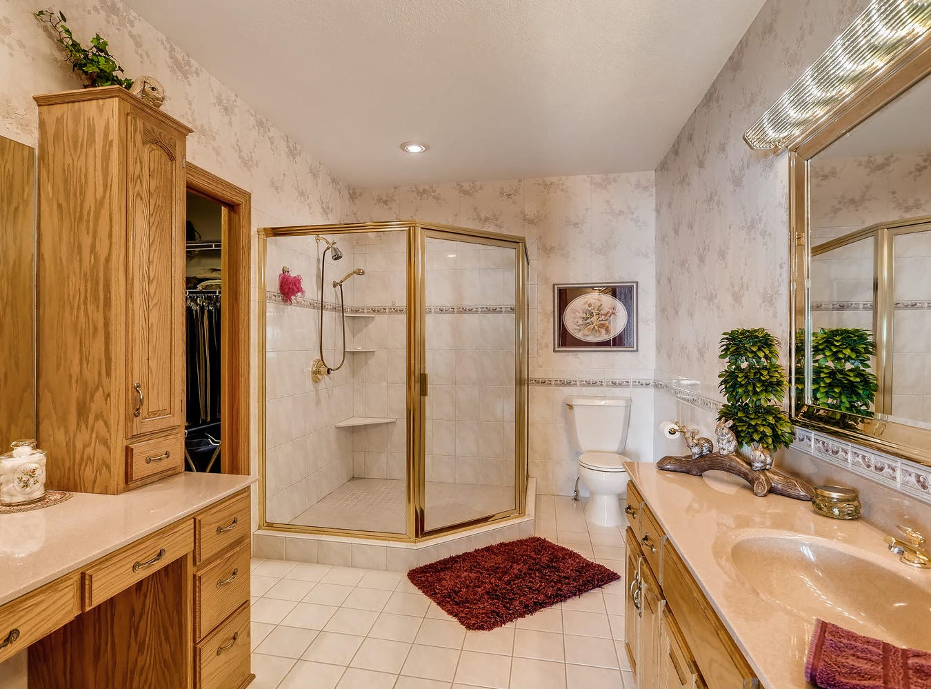 The en suite features a walk-in shower, dressing vanity and an adjacent walk-in closet.