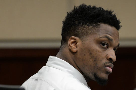 "Dujuan Barnes, on trial for first-degree murder and aggravated child abuse for the death of his then girlfriend's son, Jeffrey ""Baby J"" Phillips III in May 2016, listens as his defense attorney questions a witness Thursday, Feb. 28, 2019."