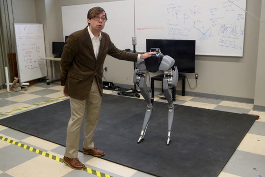 FAMU FSU College of Engineering Assistant Professor Christian Hubicki talks about Cassie, a new bipedal robot being used as a research tool in the college Thursday, Feb. 28, 2019.