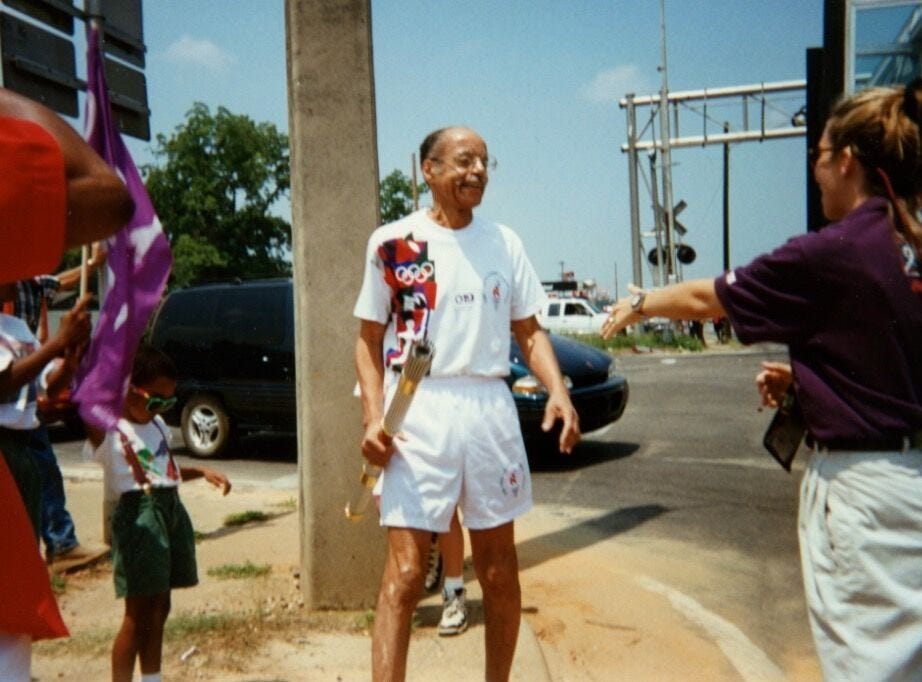 Dr. A.D. Brickler runs the Olympic Torch through Tallahassee for the 1996 Atlanta Olympic Games.