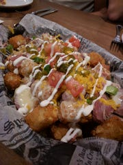 Sean Ryan Pub features the Irish-inspired nacho appetizer that substitutes tater tots for nacho chips.
