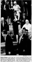 07/07/2001 Melissa O'Rourke, center in black, was escorted out of St. Patrick Cathedral on Friday after the funeral Mass for her husband, ex-County Judge Pat O'Rourke. Their daughter Charlotte O'Rourke is a top left. Businessman Jack Maxon, lower left, served as pallbearer and spoke during the service, telling friends and family about the good memories he has of O'Rourke, when they bicycled together.