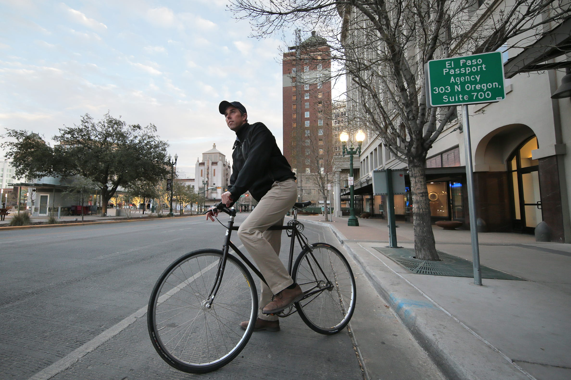 Beto O'Rourke rides off on his bike after speaking at the Moms Demand Action meeting at the El Paso Community Foundation Wednesday. O'Rourke has yet to announce his intentions for a 2020 run.