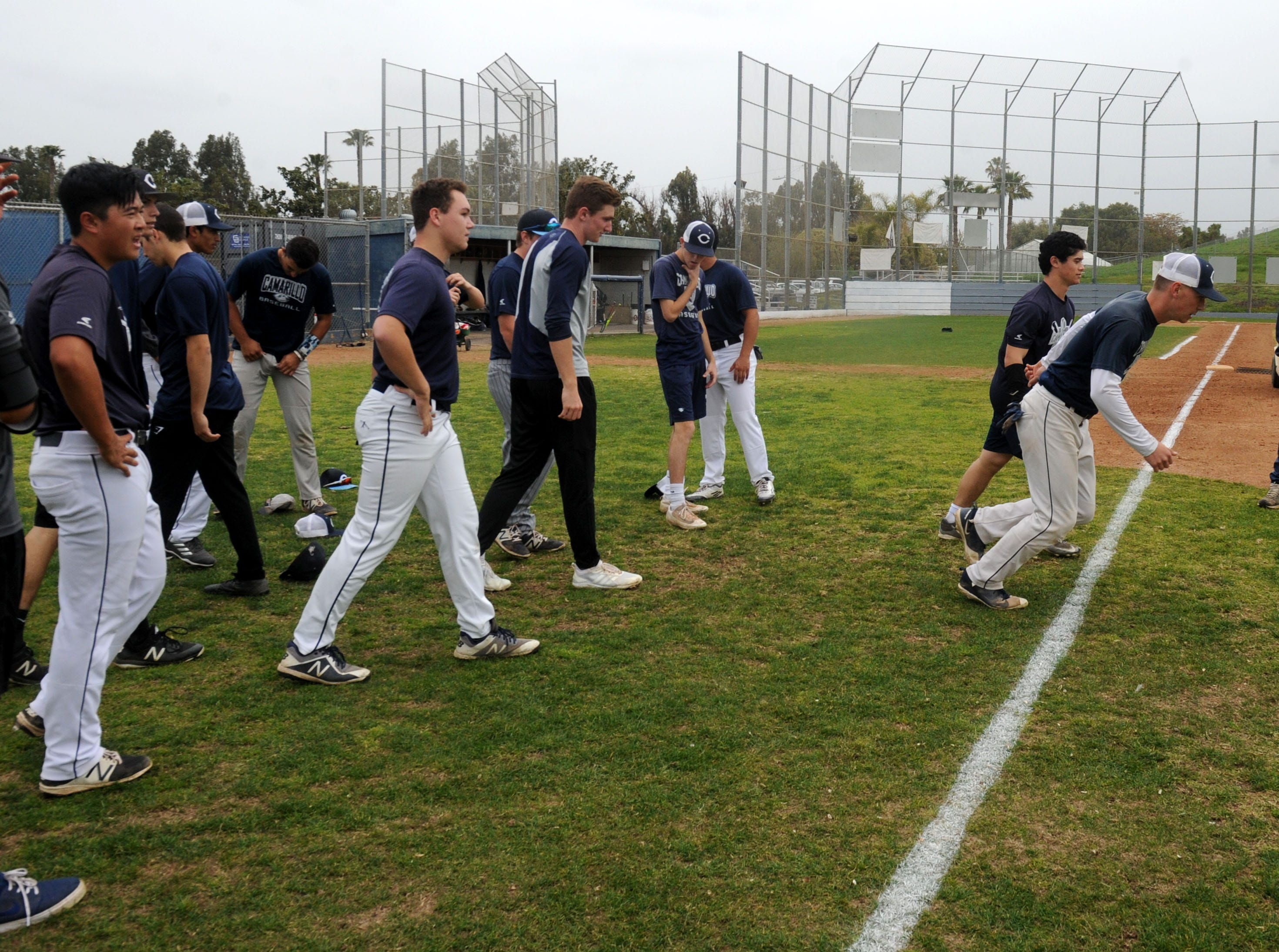 Camarillo High baseball players run a few laps around the field during Wednesday's practice.