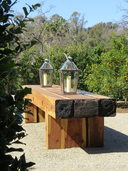 Ojai Valley School students helped build this redwood table from trees scorched in the Thomas Fire. It is on permanent display in a side garden at The Farmhouse on the grounds of the Ojai Valley Inn.