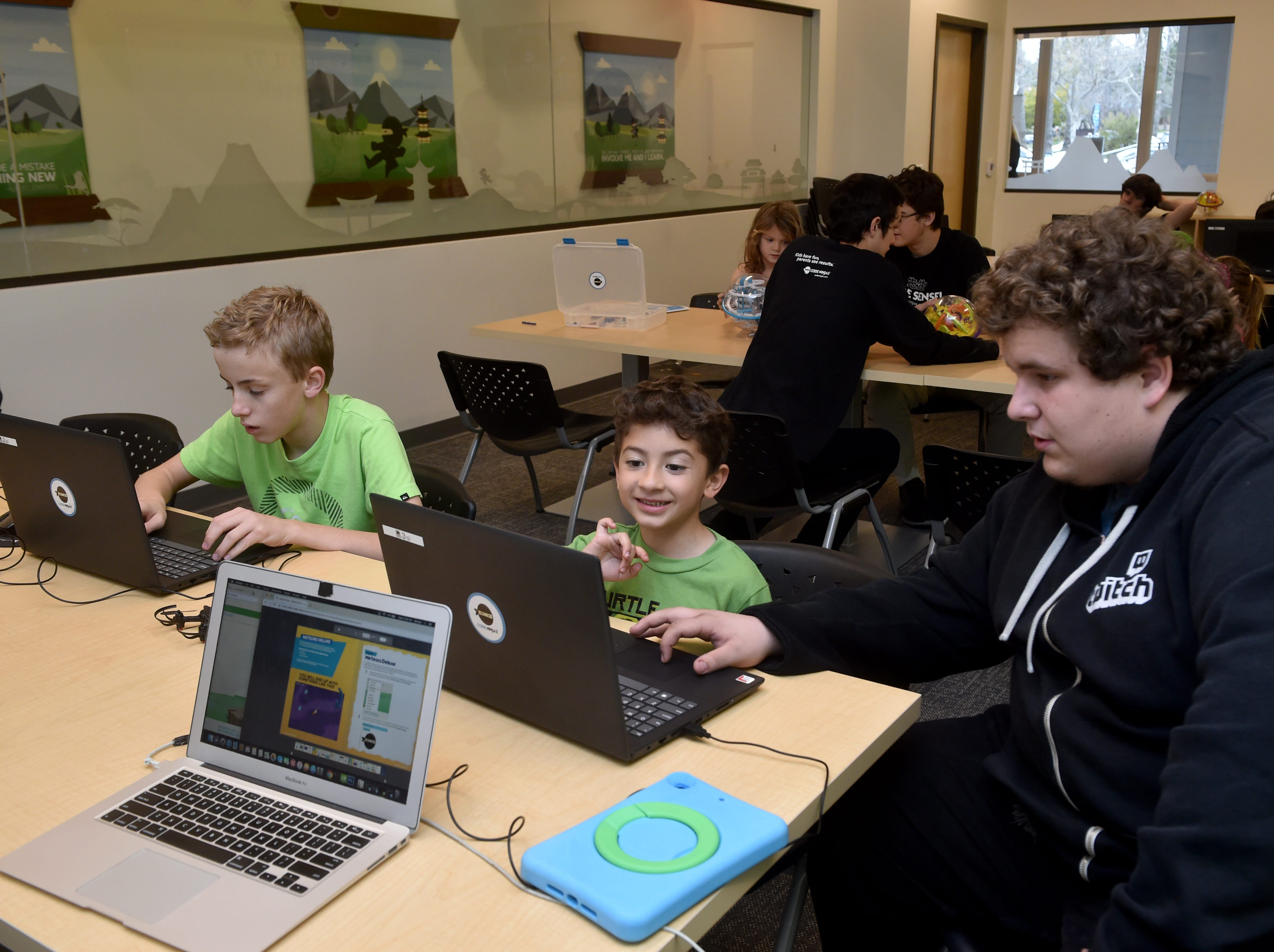 From left, Erik Bergh and Ian Melgarejo learn to create video game code at the new Code Ninjas dojo in Thousand Oaks. The facility is the first of its kind in Ventura County and the fifth franchise site in California.