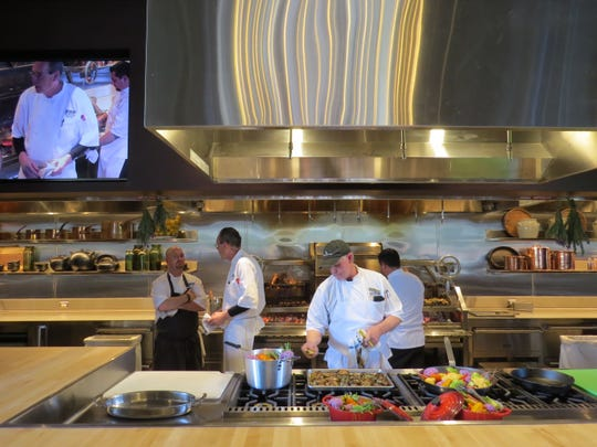Members of the Ojai Valley Inn culinary crew work in the open kitchen at The Farmhouse, the resort's new epicurean events center.