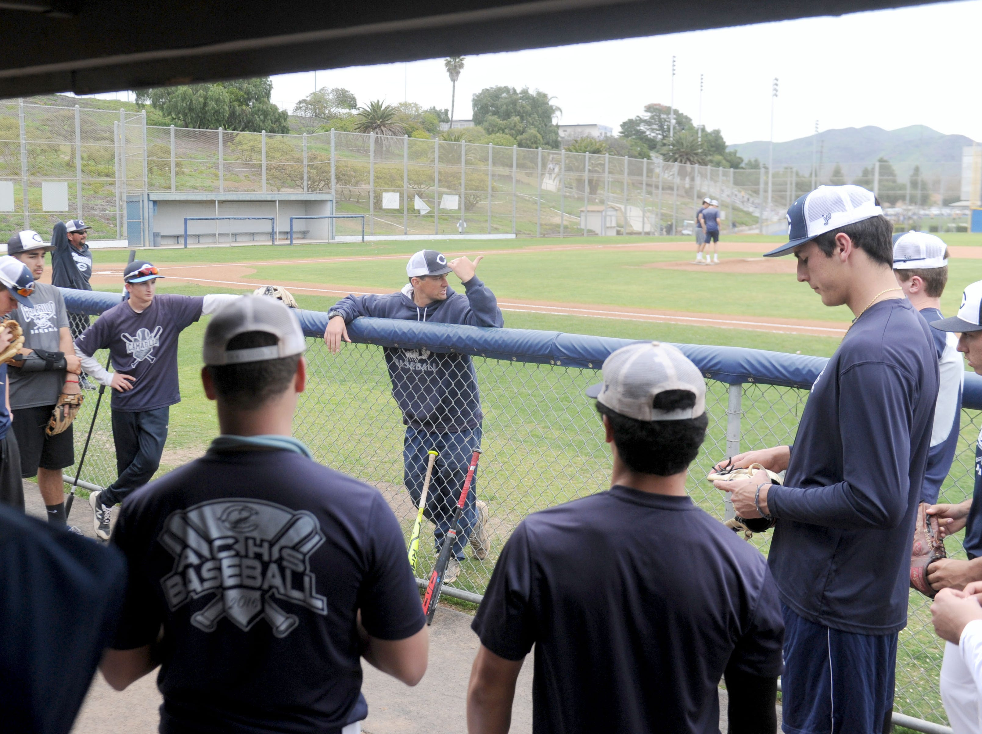 Head coach John Gonzales talks to his Camarillo High baseball team before Wednesday's practice.