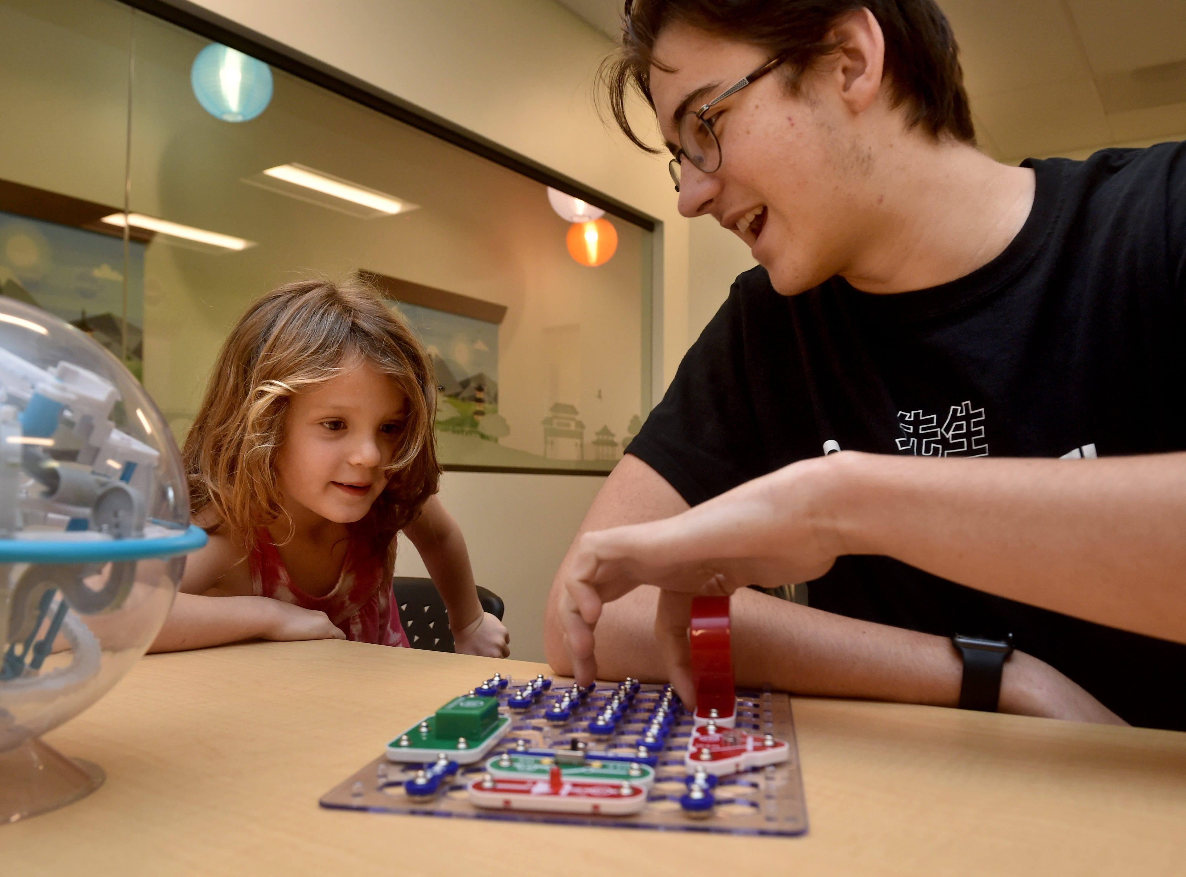 Devin Lucarelli, left, and sensei Zack Lown play with a circuit board at the new Code Ninjas dojo in Thousand Oaks. The facility is the first of its kind in Ventura County and the fifth franchise site in California.