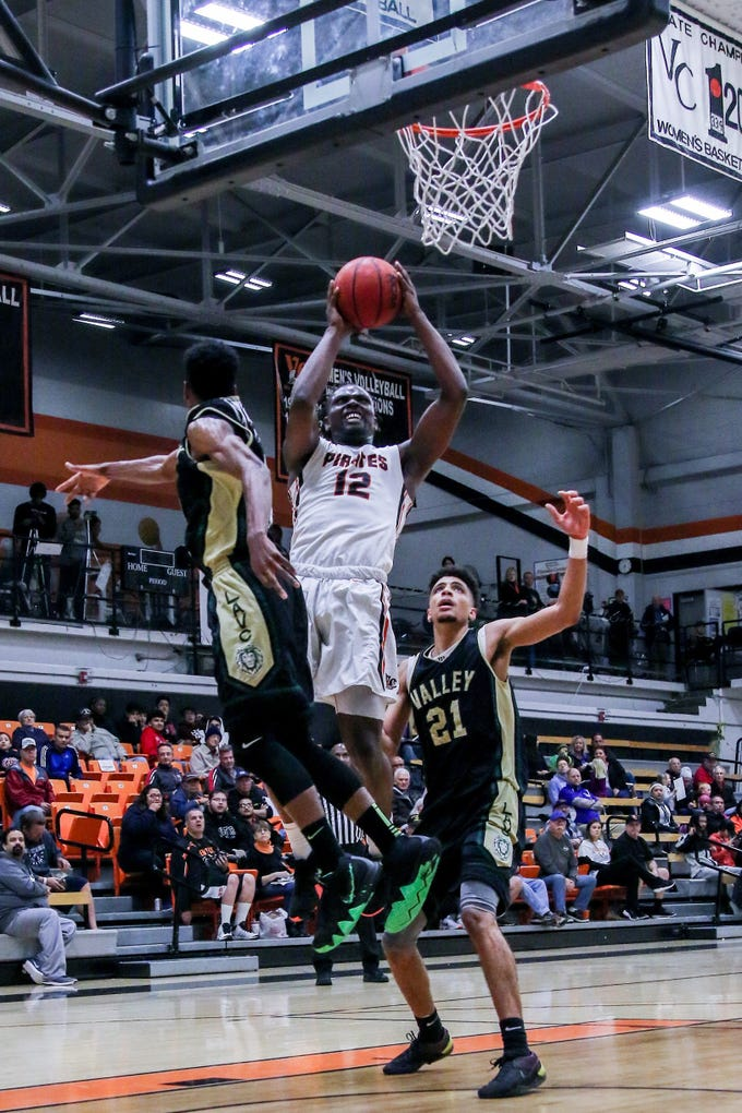 Ventura College freshman Tone Patton attacks the basket against Los Angeles Valley on Wednesday night in the CCCAA Southern California regional quarterfinals at the VC Athletic Event Center. L.A. Valley won, 78-74.