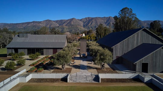An aerial view of The Farmhouse at the Ojai Valley Inn shows the building that houses The Kitchen at left, with the 8,500-square-foot Great Room at right. The $20 million project also features organic gardens, a two-story fireplace in the center courtyard and, in the foreground, an events area known as The Lawn.