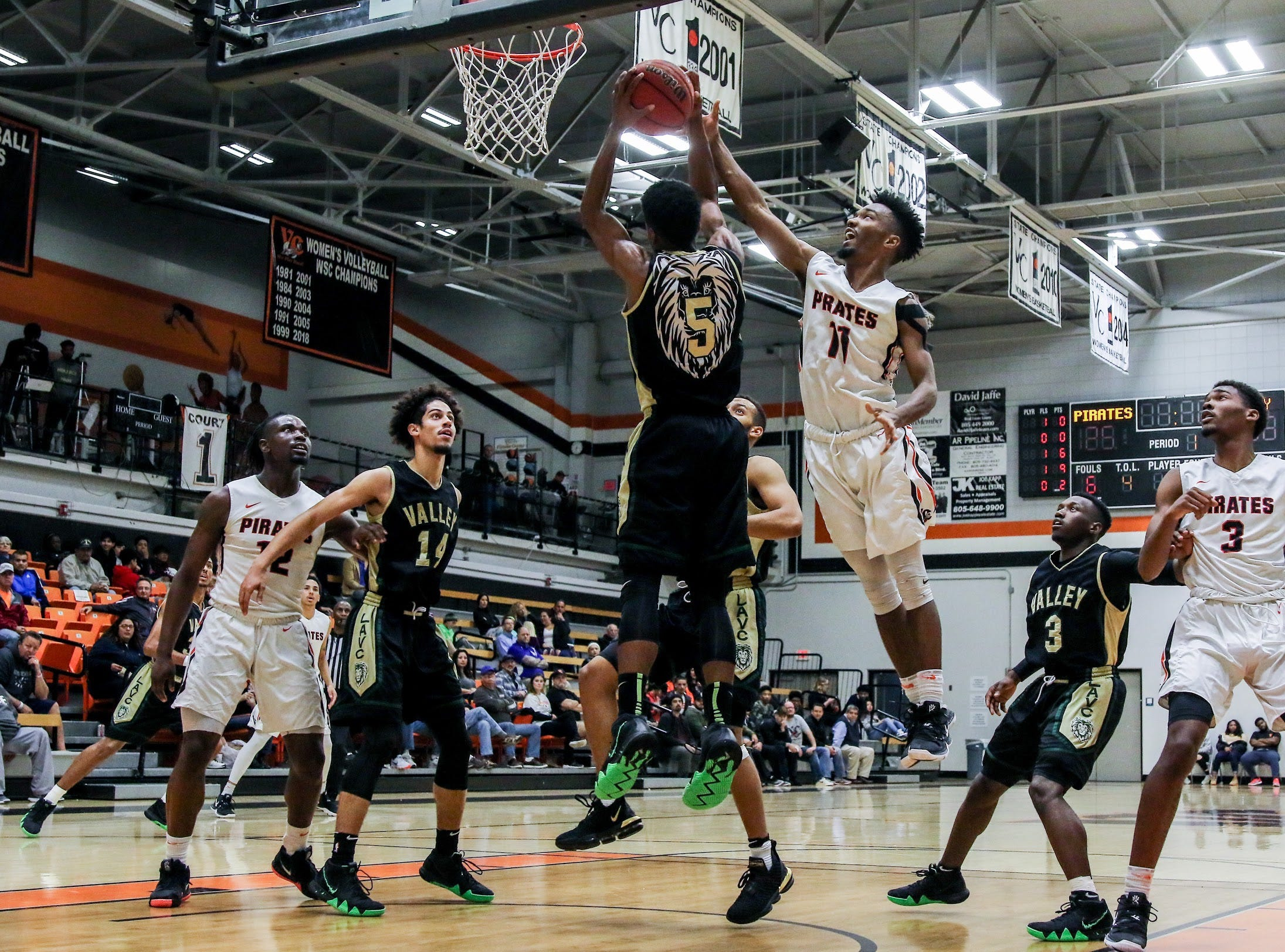 Ventura College sophomore Lamont Landers, right, challenges Los Angeles Valley's Micah Cooper for a rebound during Wednesday night's CCCAA Southern California regional quarterfinal at the VC Athletic Event Center. L.A. Valley won, 78-74.