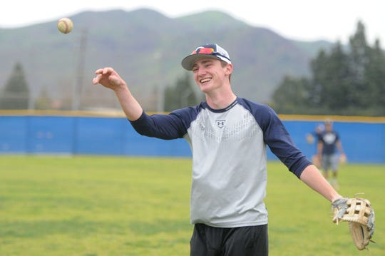 Peter Dufau plays catch during Camarillo High's baseball practice on Wednesday. Dufau is one of the top players in the Coastal Canyon League.