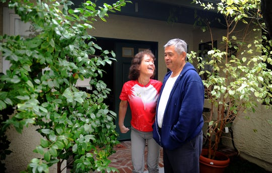 Debbie and Frank Jew enjoy looking at their front porch trees. Debbie Jew uses exercise to try to control the progress of her Parkinson's disease.