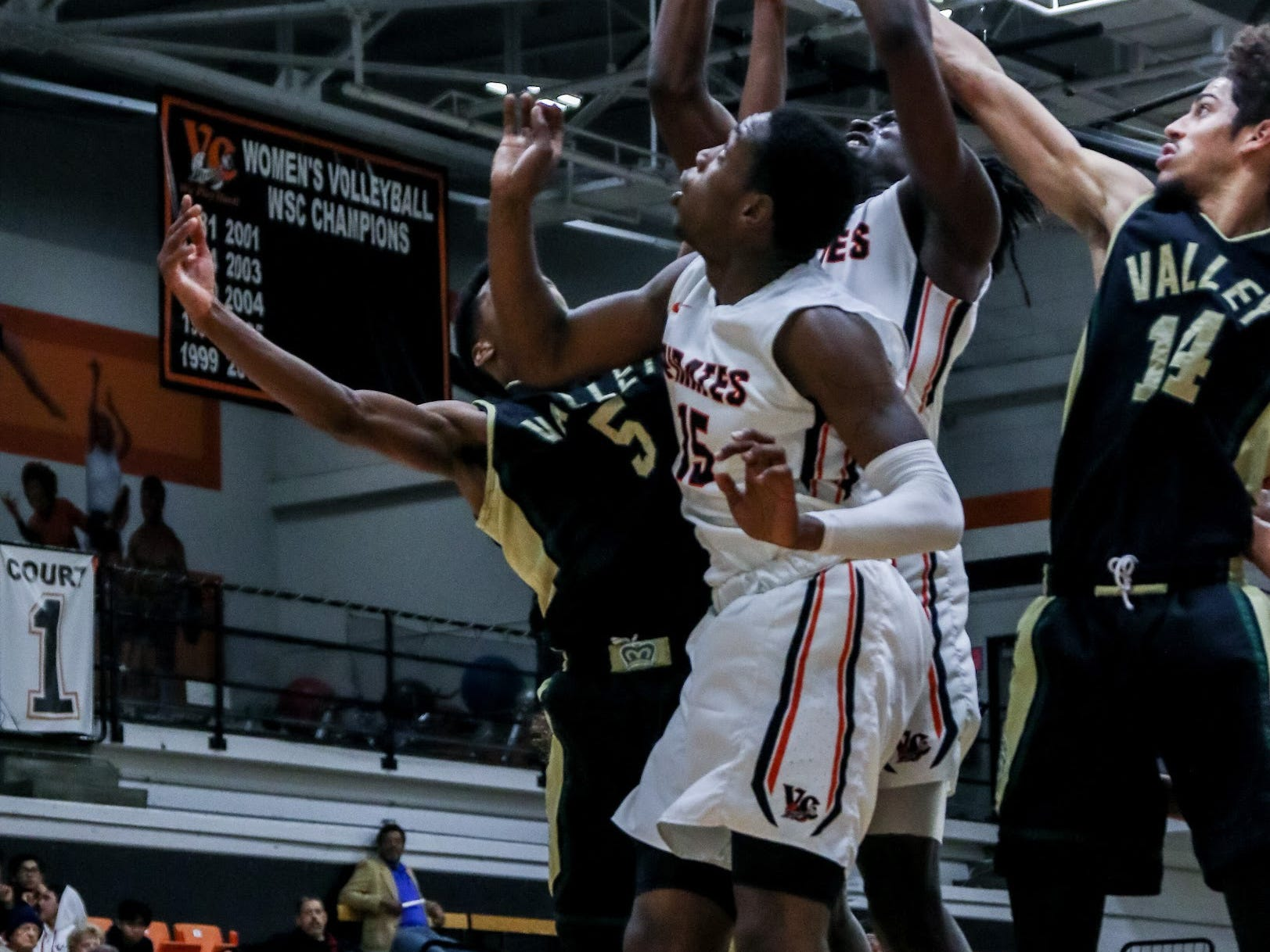 Ventura's Tone Patton grabs a rebound over teammate Dayveon Bates and Los Angeles Valley's Joshua Abrams on Wednesday night in the CCCAA Southern California regional quarterfinal at the VC Athletic Event Center. L.A. Valley won, 78-74.