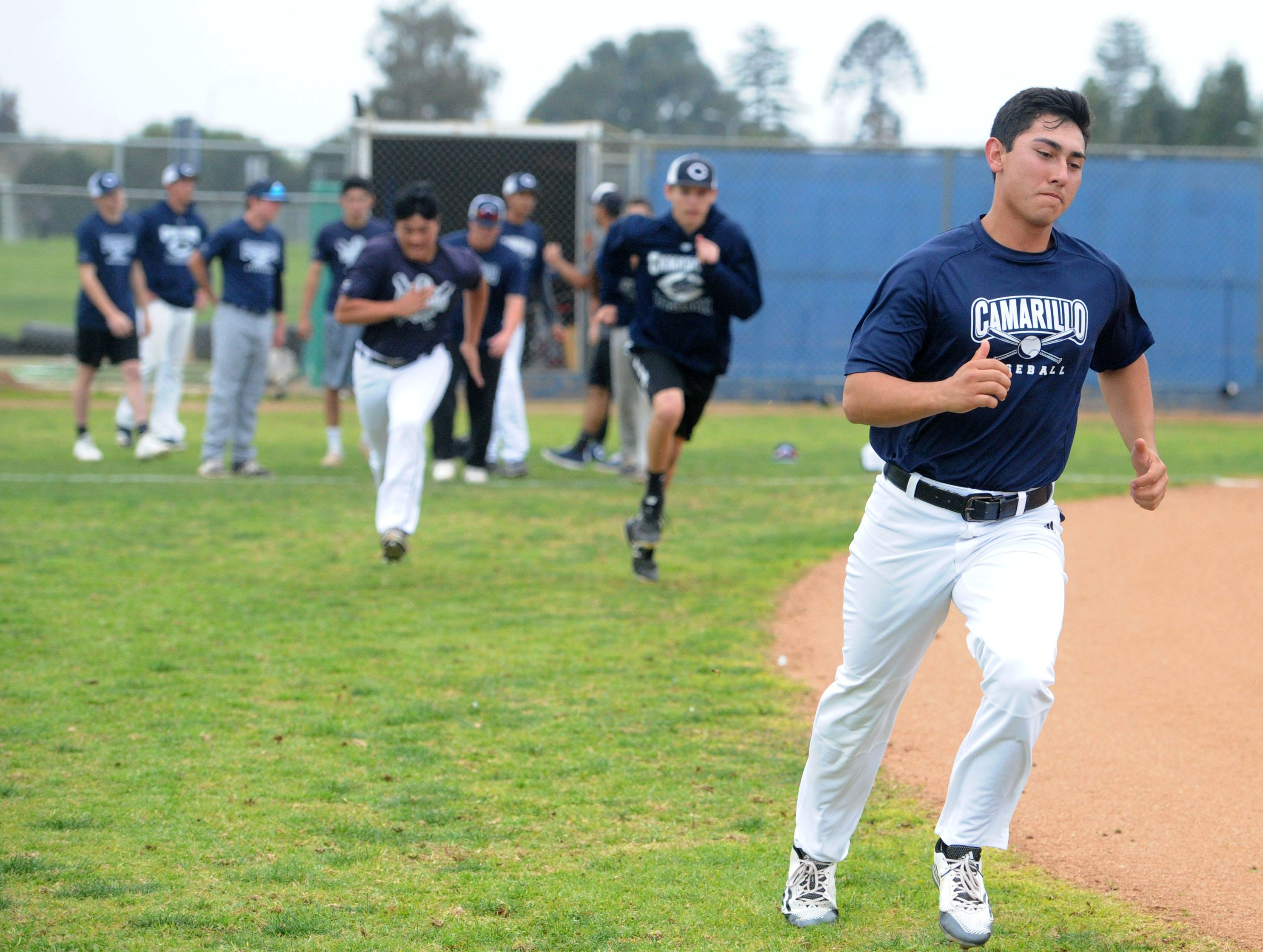 Nick Schnopp and his teammates run some sprints around the field during Camarillo High's baseball practice Wednesday.