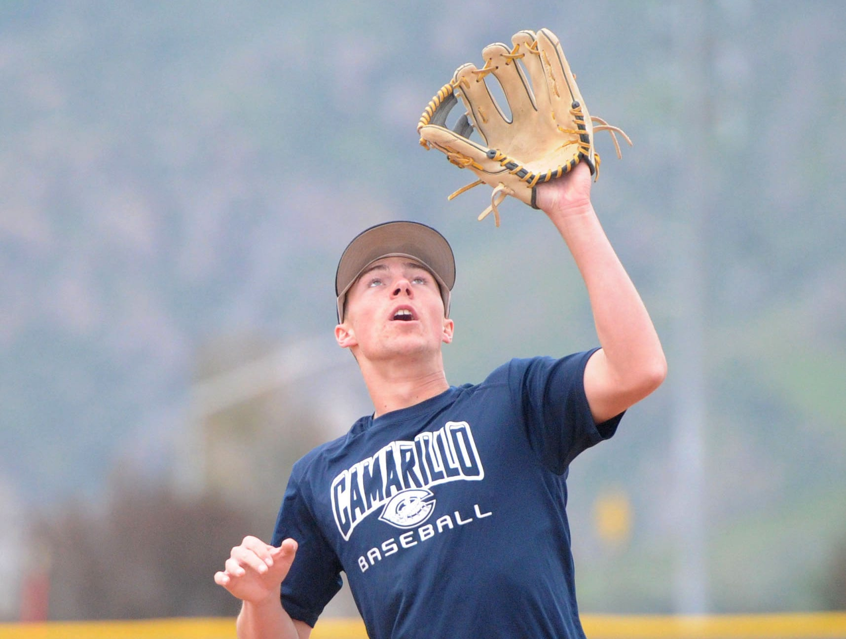 Taylor Tractenberg catches a pop-up during Camarillo High's practice Wednesday.