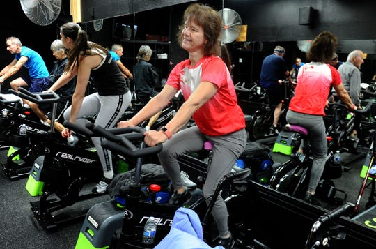 Debbie Jew gets ready to take a 30-minute spin class at Agoura Fitness in Agoura Hills. Jew, of Moorpark, was diagnosed 13 years ago with Parkinson's disease. She uses exercise to try to control the disease's progress.