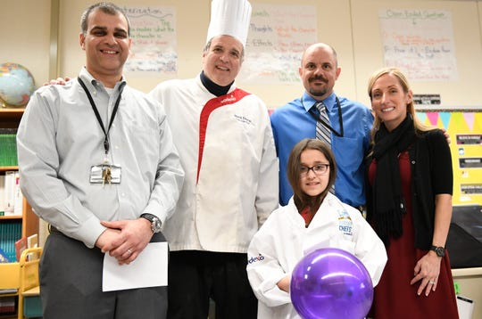 From left to right, Purvesh Patel, Sodexo chef Mark Daino, Principal Dan Greco and Vice Principal Meghan Youngblood pose for a photo with McKenzie Broyles, who was selected as a finalist for the upcoming Future Chef competition.