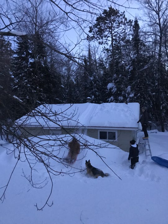 Wisconsin natives can always find a way to make a fun situation out of a snowy situation. Hayden Davison, Alex Gengler and Cole Gengler enjoy the Wisconsin snow by turning a roof into a sledding hill in Eagle River.