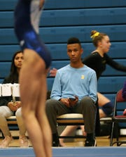 Ossining's Cruz Vernon watches as gymnast compete in the Section 1 Gymnastics Championships at Carmel High School Feb. 7,  2019.