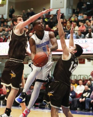 Suffern's Clev Lubin (5) has his path to the basket blocked by Clarkstown South's Ryan Giordano (31) during the boys Class AA basketball semifinal at the Westchester County Center in White Plains  Feb. 27,  2019. . Clarkstown South won the game 43-38.