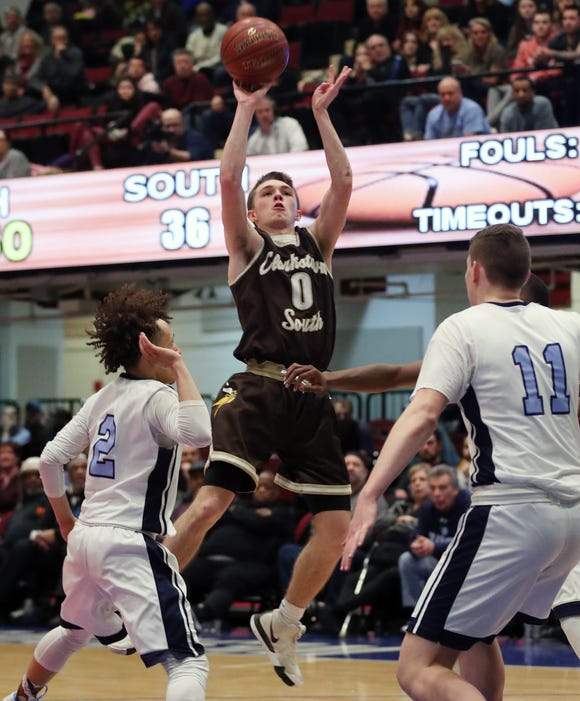 Clarkstown South's Jack Tucek (0) puts up a shot late in the game against Suffern during the boys Class AA basketball semifinal at the Westchester County Center in White Plains  Feb. 27,  2019. Clarkstown South won the game 43-38.